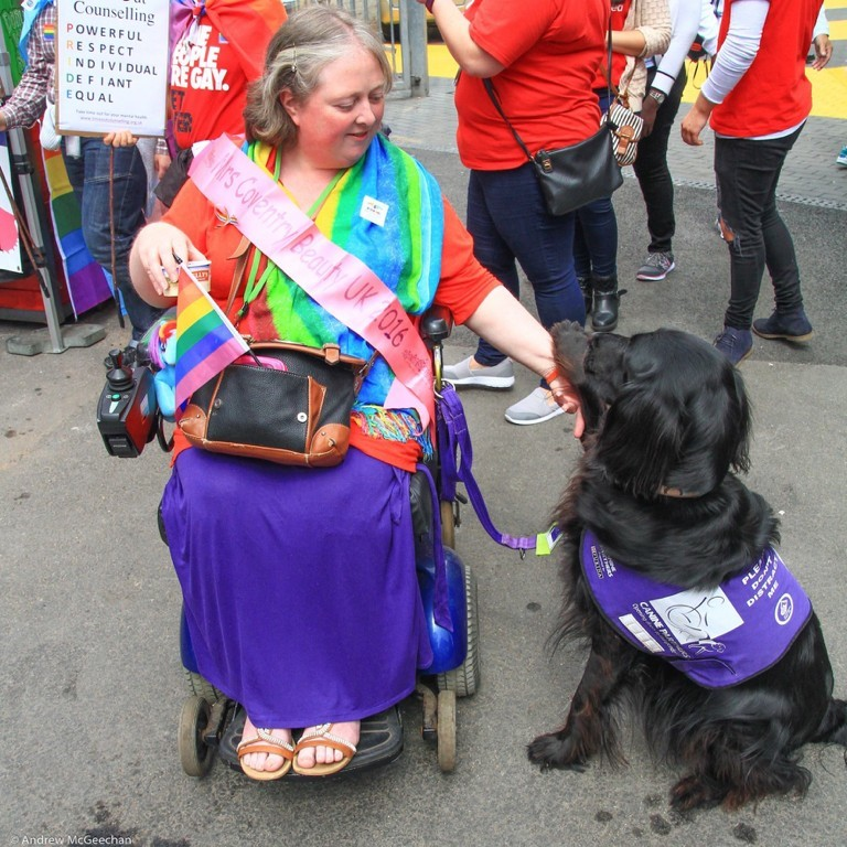 Tracey at Pride with her assistance dog