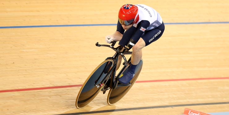 Athlete cycling with adapted bike. Photo Credit: paralympics.org.uk