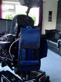 Feed and bag on rear of wheelchair