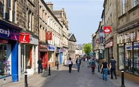 UK high street with shops and cafes